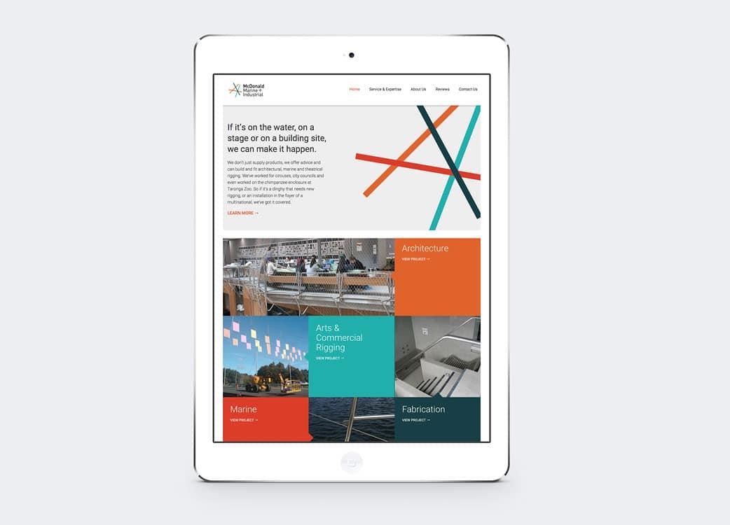 Responsive website design shown on iPad for McDonald Marine