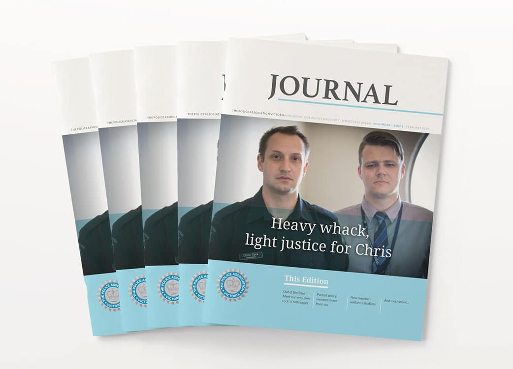 Splayed out printed copies of Police Journal