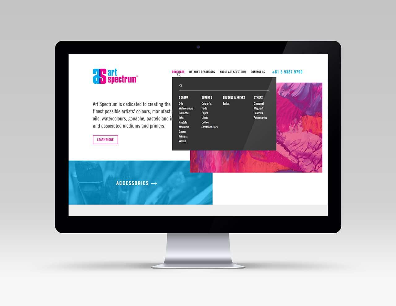 Art Spectrum homepage desktop design on iMac