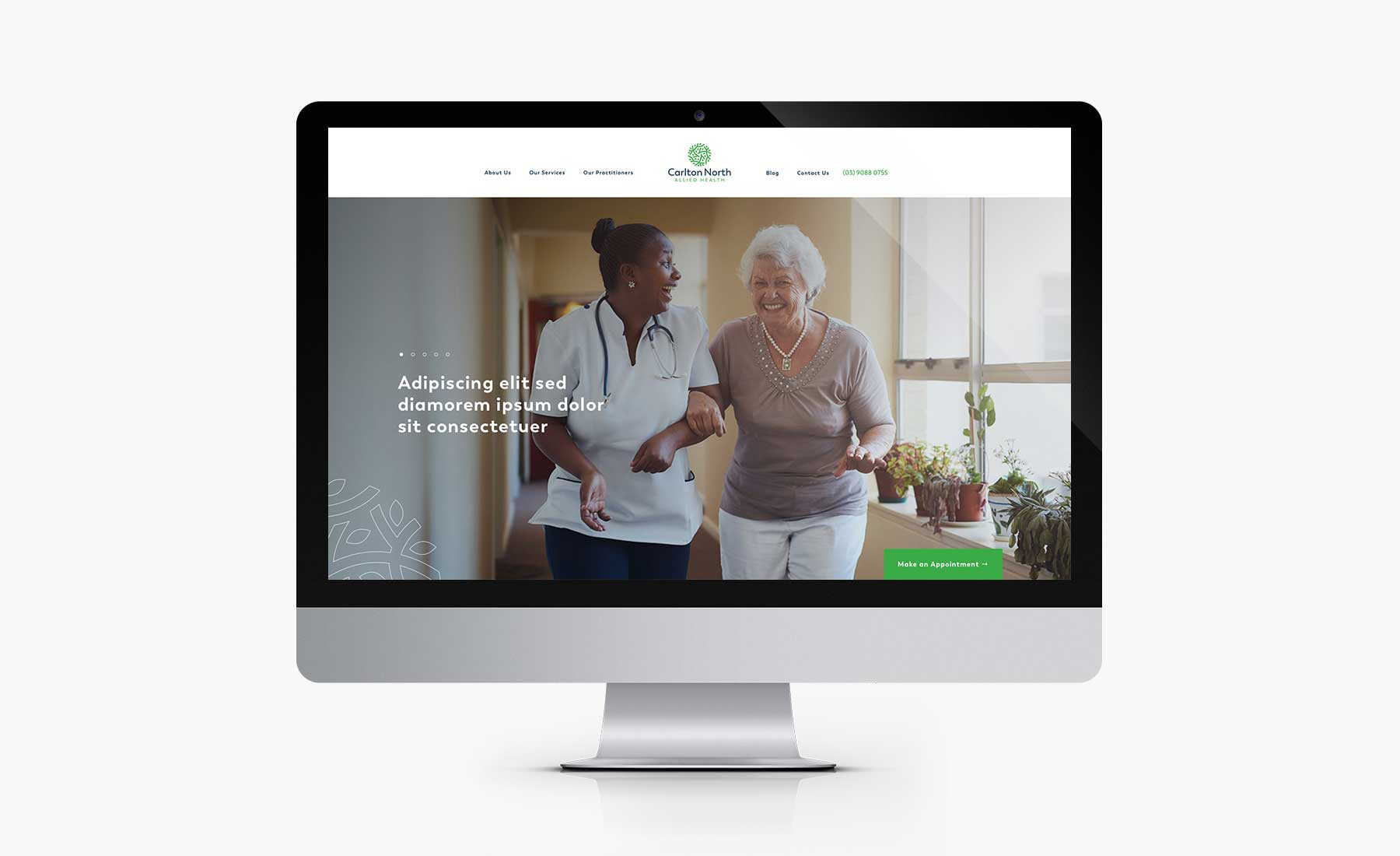 Carlton North Allied Health (CNAH) homepage desktop design on iMac